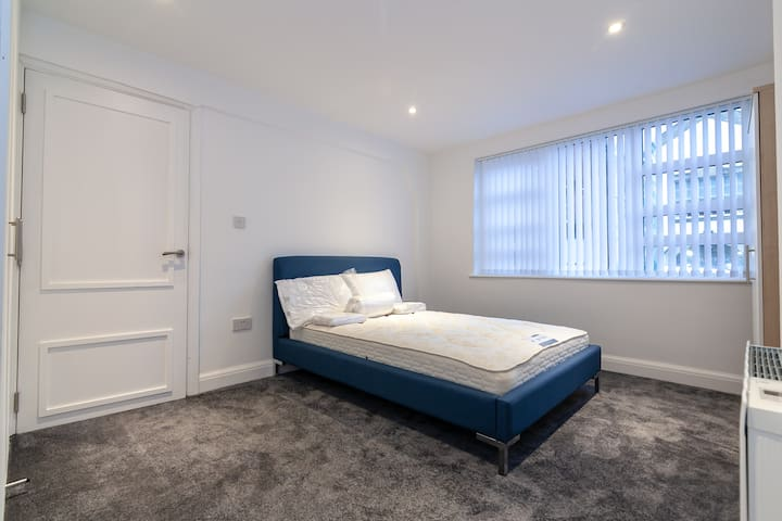 Room 1: Large bedroom with a double bed.