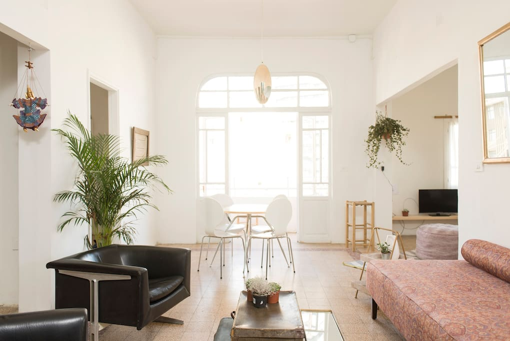 Plants, comfy sofas and stacks of books placed around the flat give the space a very homey yet stylish feel.