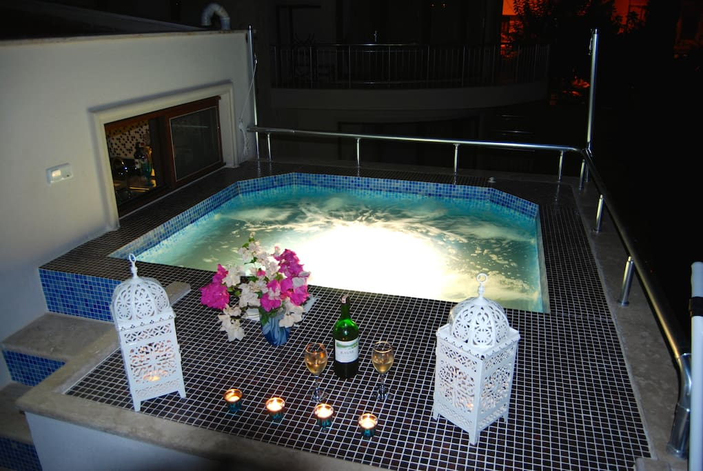 Spa pool (at night) on roof terrace