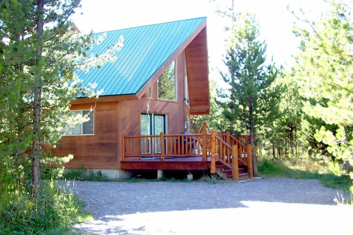 Cabin in the Trees is surrounded by natural wilderness.