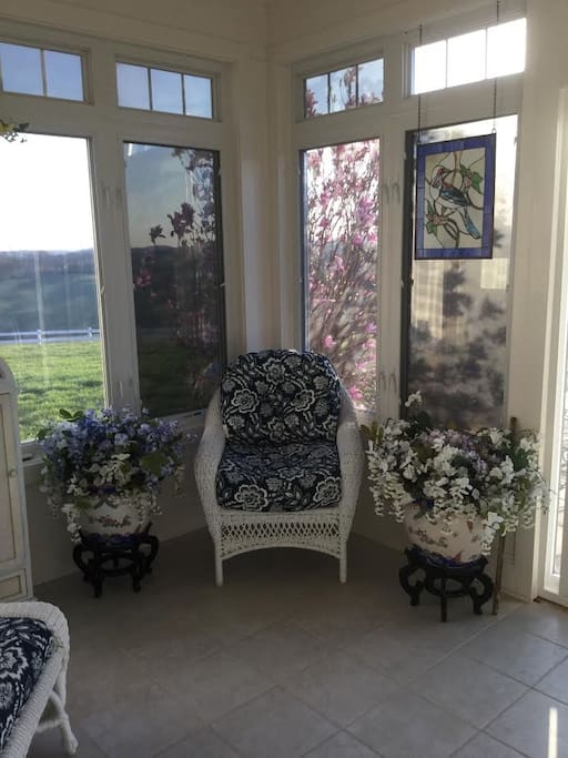 enjoy the lovely sunroom with beautiful views and direct access to the pool and hot tub
