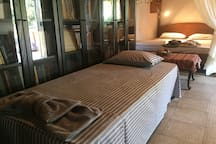 Bedroom 1 - One of the single beds and the Queen-size Canopy Bed at the back