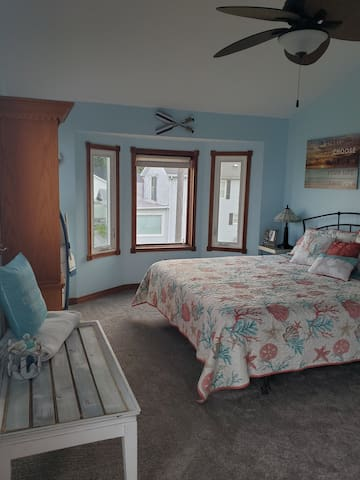 Master bedroom suite with king size bed. Bedroom on 2nd floor.