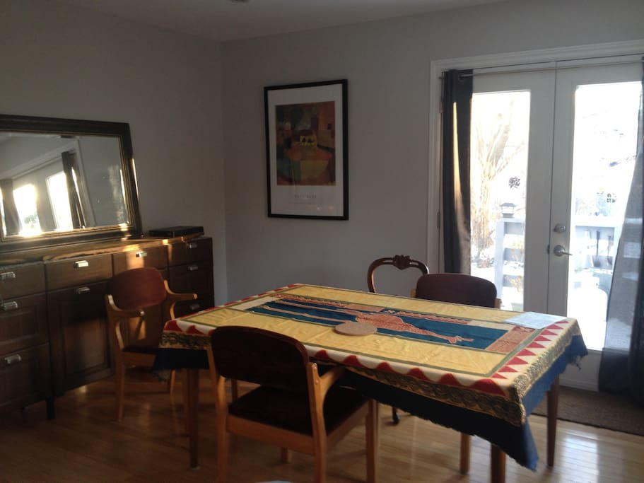 Dining room table expands or makes smaller, looks out to deck and yard