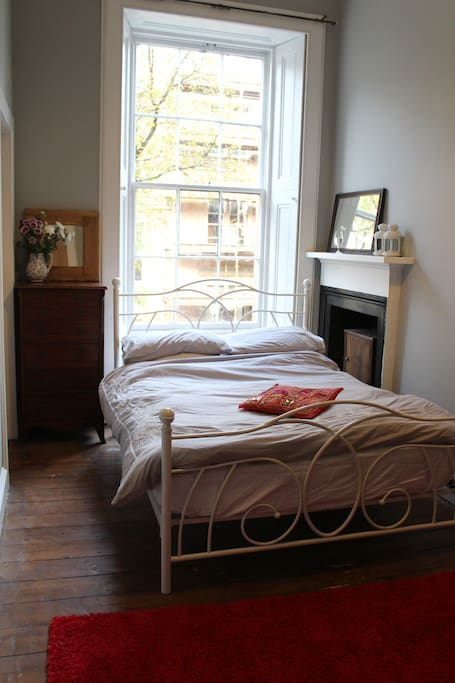 Double bed. Window with shutters