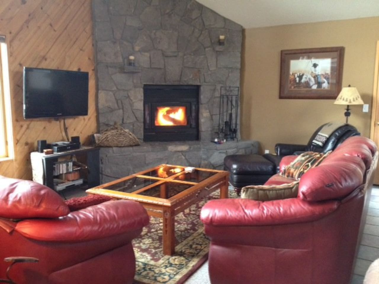 Great room with wood burning fireplace and flat screen TV