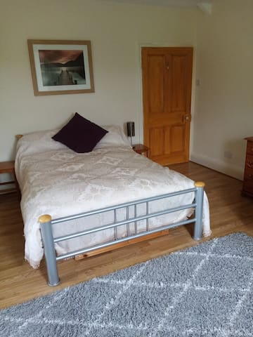 This is an extra large room offering comfortable and space and includes a two-seater sofa.