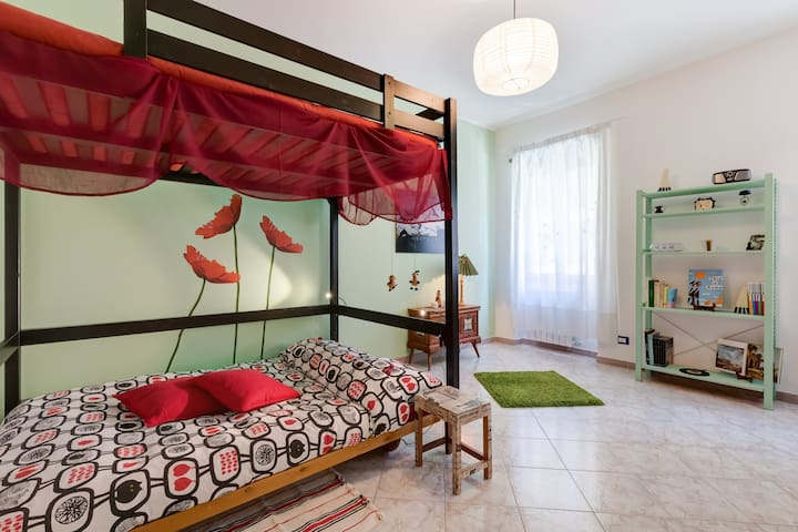 Bedroom with  poppies on the wall