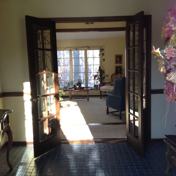 2 story foyer with french glass doors looking into living room