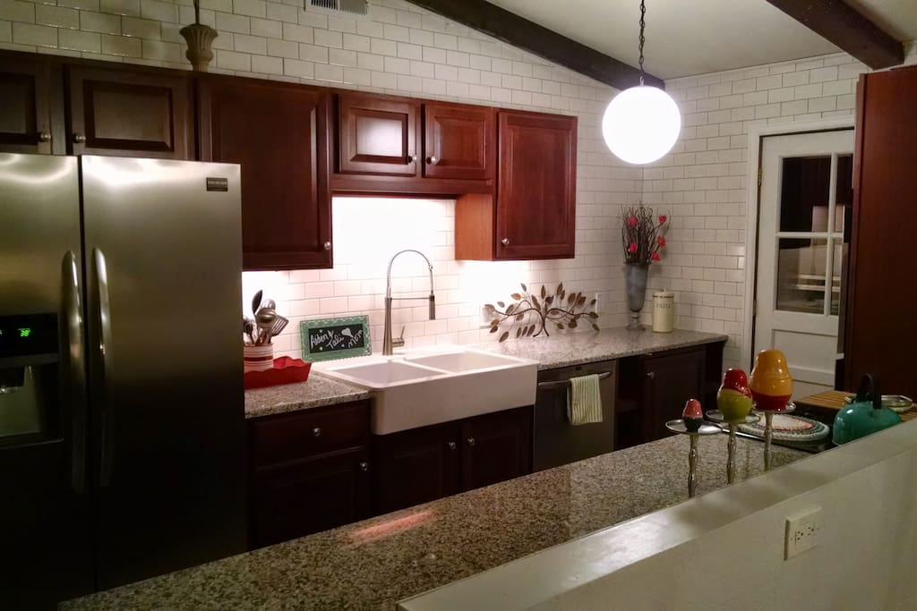 Kitchen - Stainless appliances, farmhouse sink, subway tile