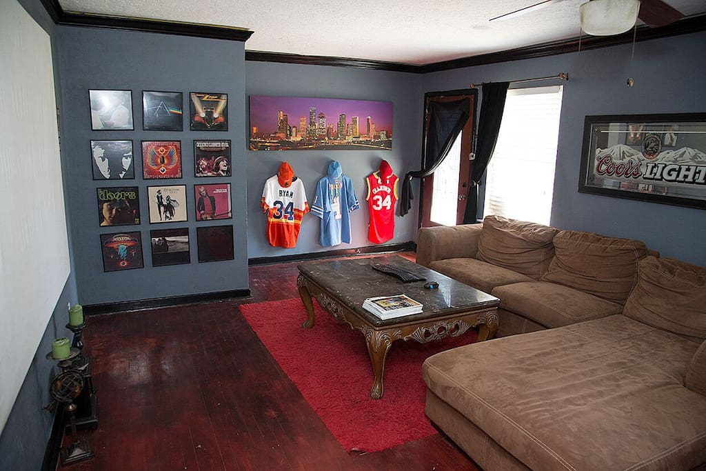 The front living room is a comfortable space, decorated in sports memorabilia and rock & roll album covers, well suited to casual entertaining.