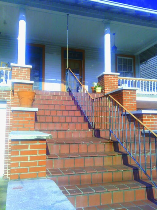 Stairs..wide open porch looking out over Ursulines Ave in the Midcity, the heart of New Orleans!