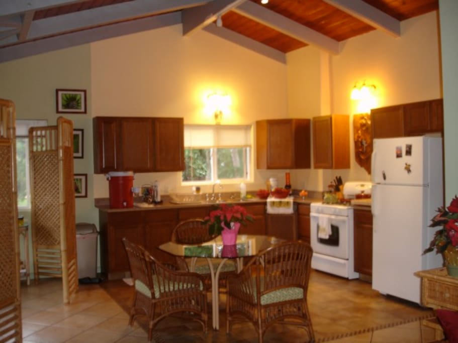 full kitchen with coffee, tea, and other stocked stables.