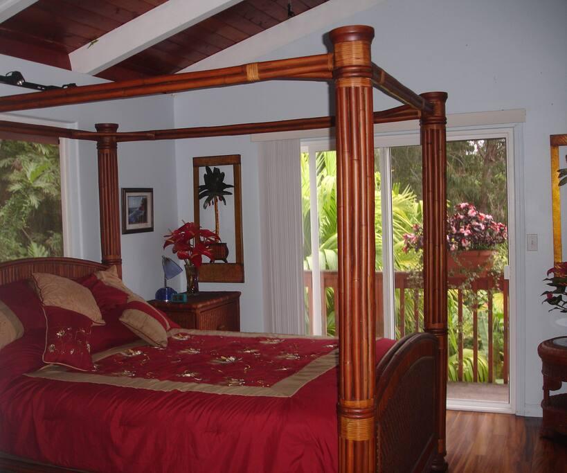 Bedroom has sliding glass doors with balcony.