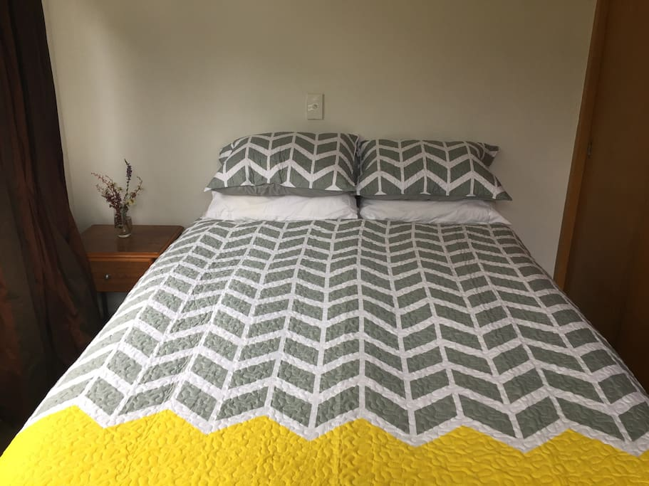 Cosy comfortable double bed with mattress topper and new quality bedding.