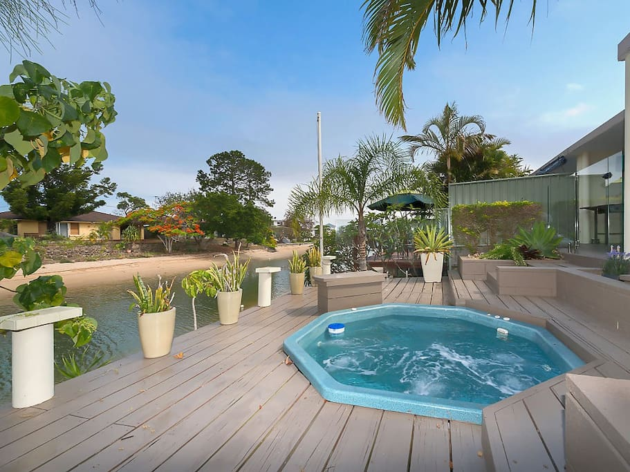Private Exclusive Waterfront Backyard with soft jet jacuzzi
