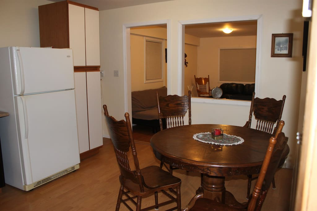 Comfortable seating area in the kitchen overlooks the living room.