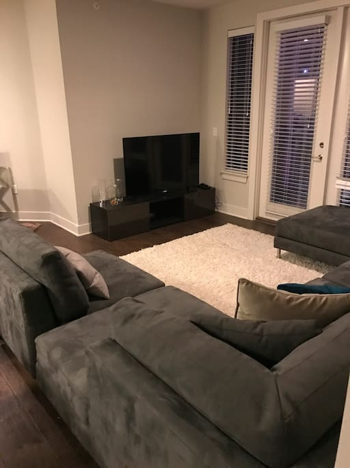 Living room area with smart TV to connect to your hulu, netflix, ect.