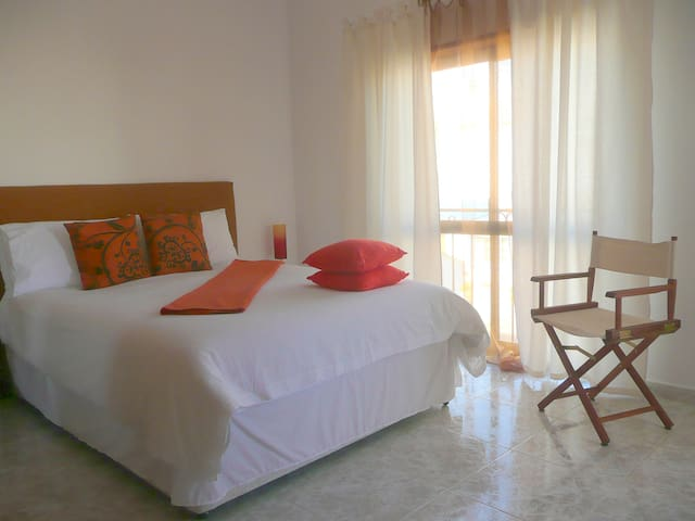 Double bedroom with double/twin beds, balcony and en-suite