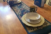 antique table and chairs in  eating area