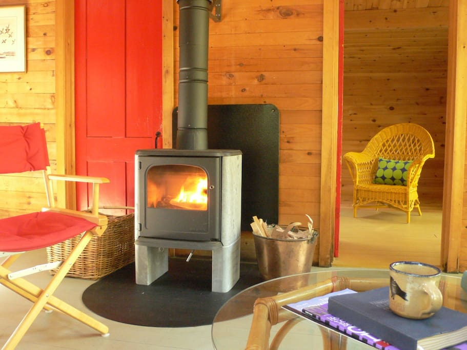 An elegant woodstove warms the camp on cool mornings.