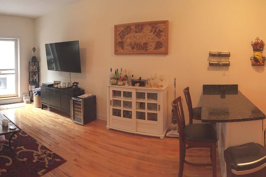 Full wide shot of the living room/kitchen as you enter the apartment.