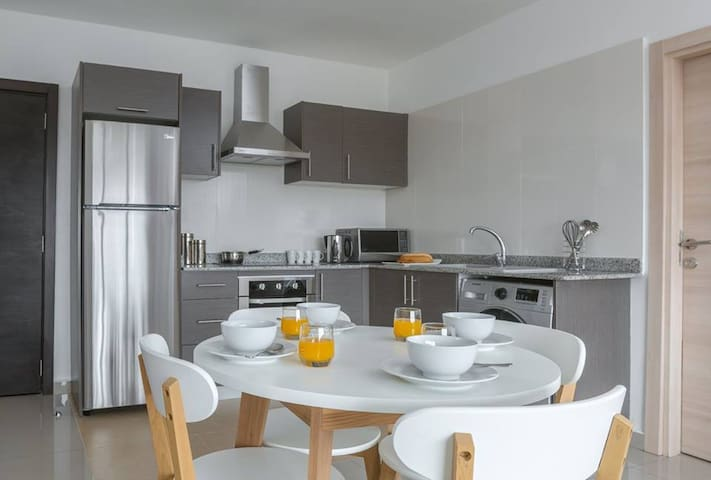Kitchen and dinning area (all you need for cooking including pans and kitchenware and washing)