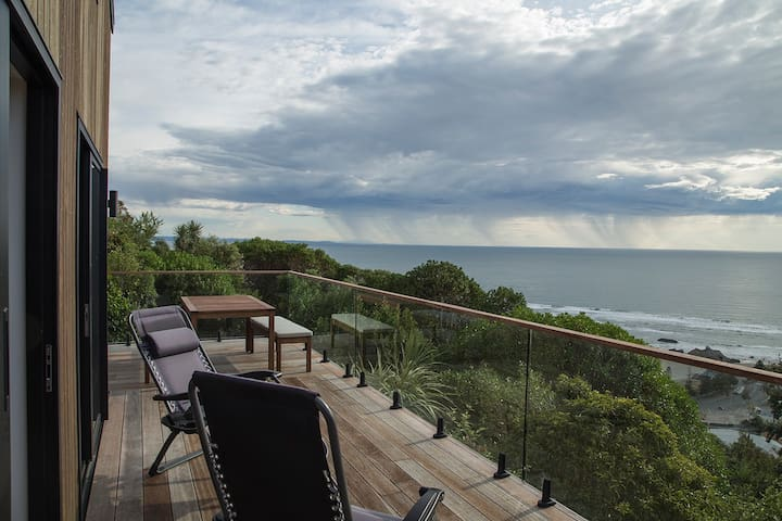 New eco-house with stunning Sumner Beach views.