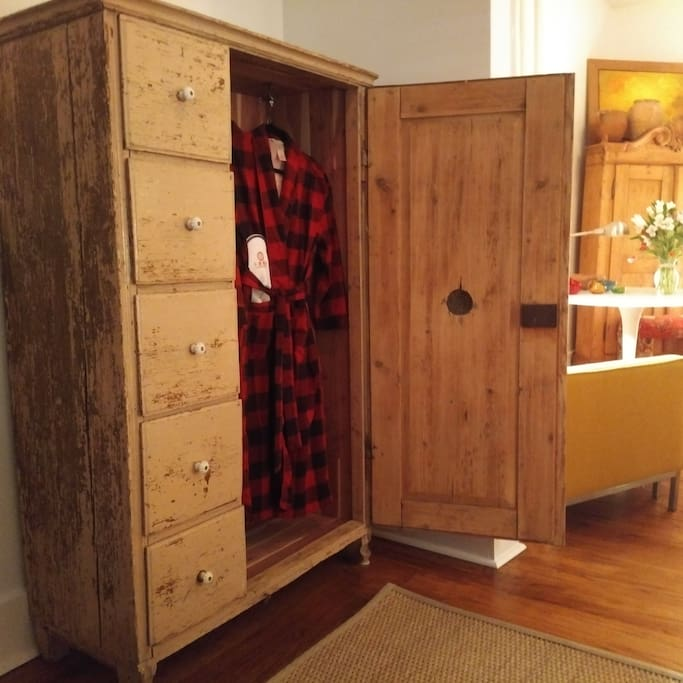 Refurbished pantry cupboard, lined with cedar, with winter flannel robes, and hangers.