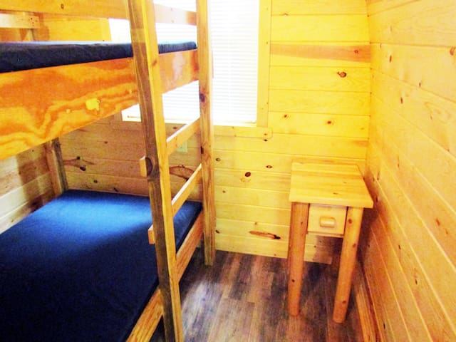 A set of bunks is perfect for the kids. There is a small end table for your goodies!