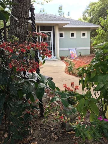 "We love to garden! We actually designed the Little House ""in compliance"" with an overhanging Live Oak tree!  The house is surrounded by beautiful gardens, which we invite you to stroll and enjoy at your leisure."