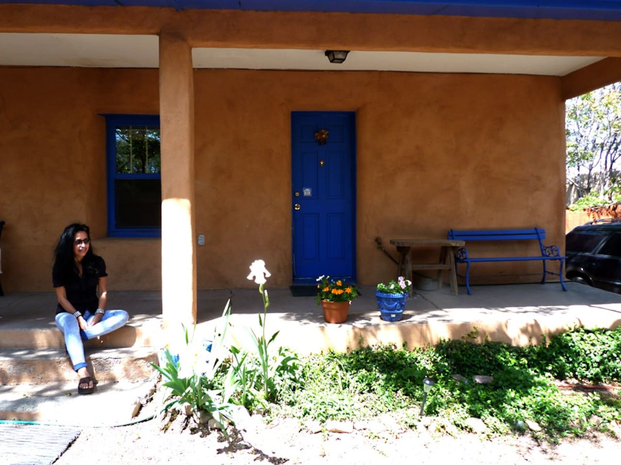 This is the front of the house with a guest.