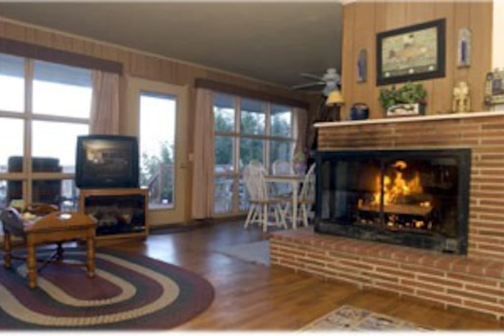 A large fireplace upstairs.