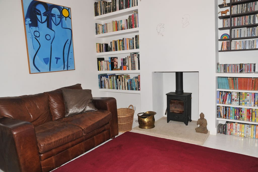 Sitting room with log burning stove. Also has 40 inch TV and hi-fi stereo system.