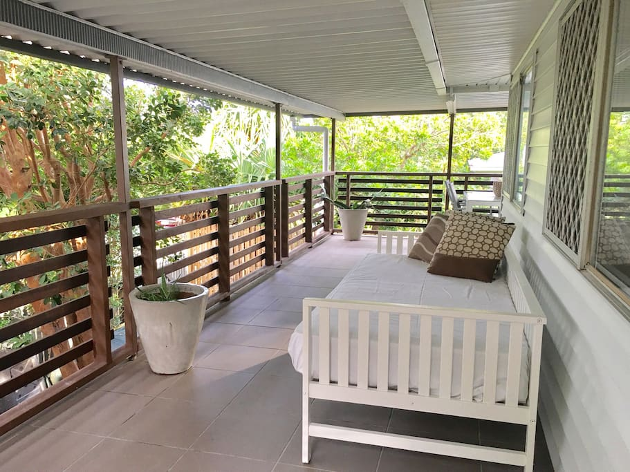 Large wrap around deck with cozy daybed.