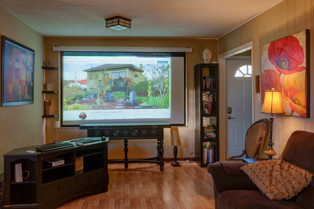 Lower the big screen to convert living room to media room for movie nights!