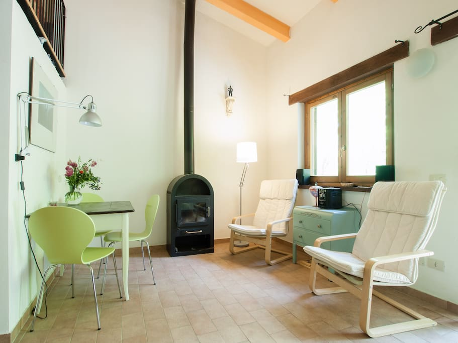 cosy living room with wood stove in summer