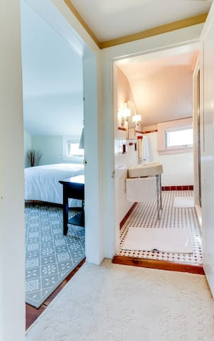 bathroom is located right by your bedroom. It is shared with other guests.