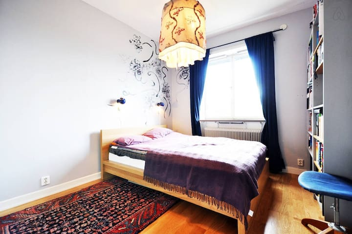 Your room, the master bedroom. Nowadays there is a desk next to the bed so you can work if needed.