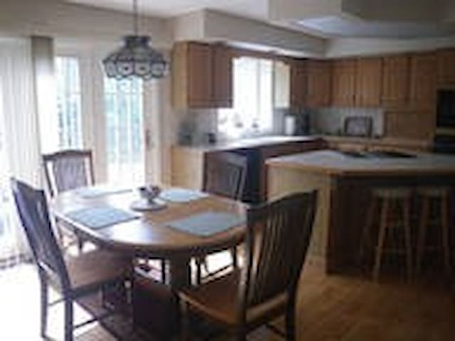 Large eat-in kitchen that is fully stocked
