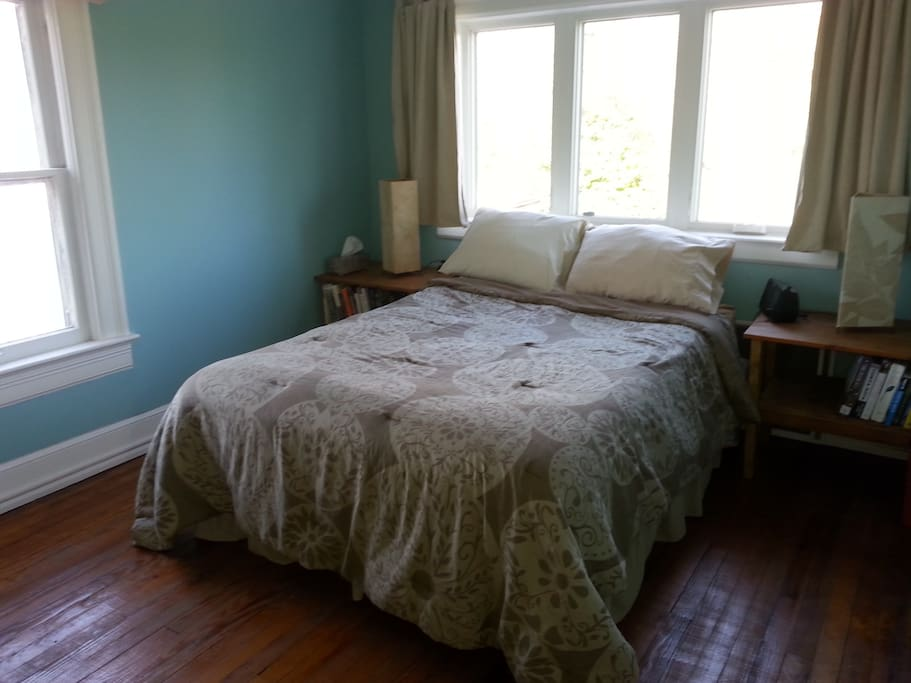 This bedroom has a firm double bed with a big window overlooking the backyard.