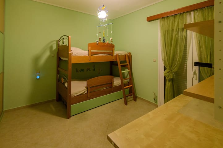 Green bedroom, second level-3 beds (twin bunk beds with pull out bed)/ Balcony with side sea view