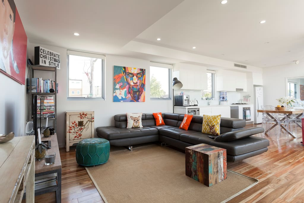 Large, bright, modern living space with solid wooden floors and 360 degree natural light.