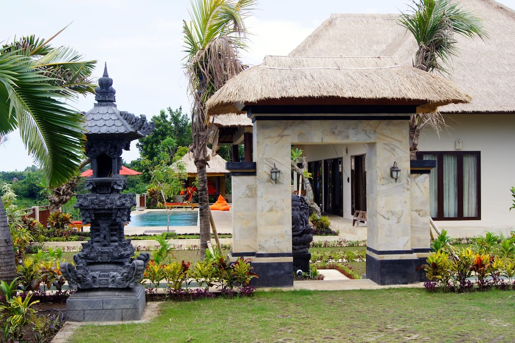 A small Balinese temple and a Ganesha statue welcome you through the traditional Balinese gate