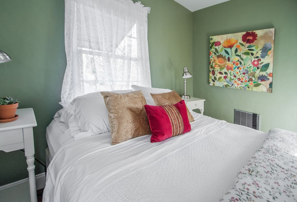 The queen bed is dressed in 100% cotton bedding for a comfortable night's sleep.