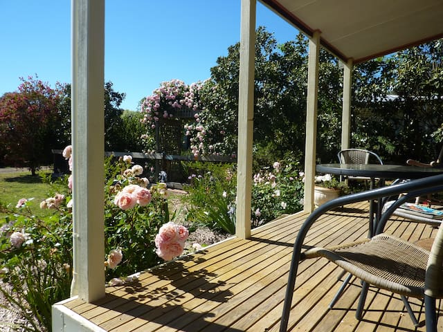 Enjoy a wine on the front verandah.