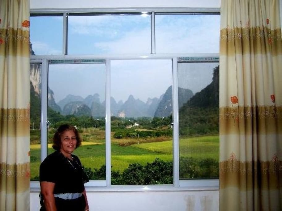 Stay at Yangshuo Moon Resort, In the bed see outside view