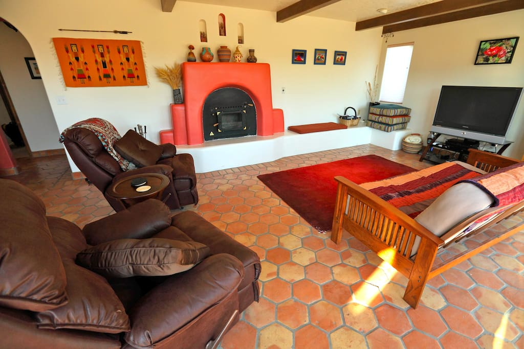 Living room with a 'kiva' style fireplace