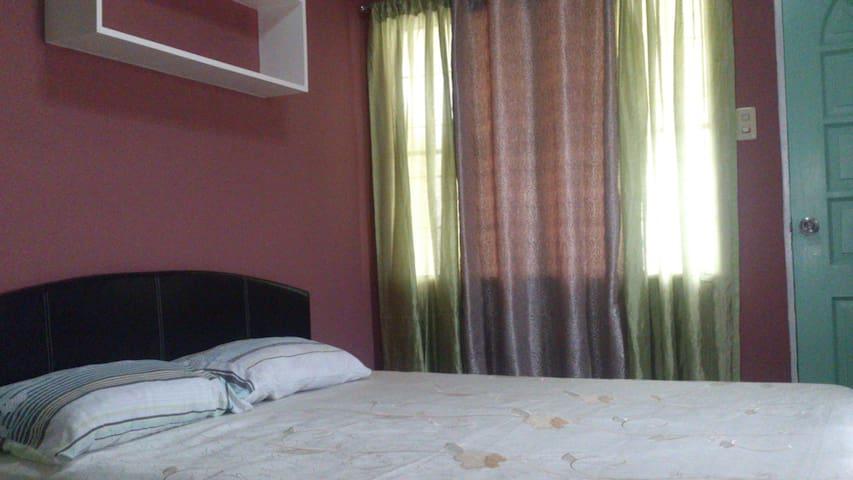 Room #1 Queen sized bed
