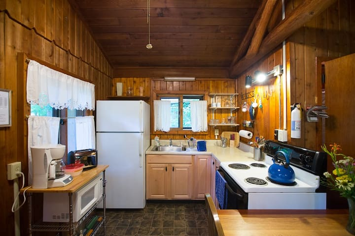 Well equipped kitchen is convenient and economical for travelers.